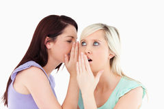A young woman telling her friend a secret Stock Photo