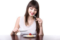 Young woman tempted to eat cake Stock Image