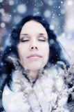 Young woman tender portrait with snow Stock Image