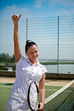 Young woman on a tennis court Stock Photography