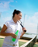 Young woman on a tennis court Stock Images