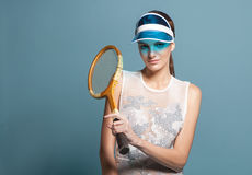Young woman tennis player in sun visor holding tennis racquet Royalty Free Stock Image