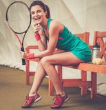 Young woman after tennis workout Royalty Free Stock Images