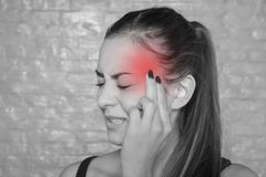 Young woman with a terrible headache Stock Images