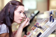 Young woman testing cosmetics Royalty Free Stock Image