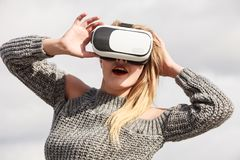 Woman wearing VR outside stock photography