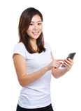 Young woman text on cellphone Stock Photos