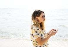 Young Woman Texting On A Beach