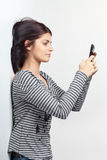 Young woman texting with cellphone Royalty Free Stock Photos