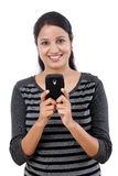 Young woman texting on her mobile phone Stock Photo