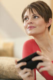 Young Woman Texting at Home Stock Images