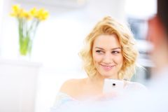 Young woman texting at home Stock Photos