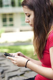 Young woman texting a message Stock Image