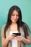 Young woman texting messages on mobile phone Stock Photo