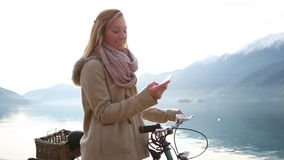 Young woman texting with mobile phone stock video footage