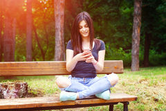 Young woman texting Stock Images