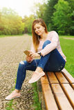 Young woman texting Royalty Free Stock Image