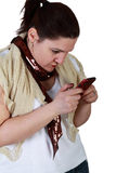 Young woman texting on smartphone Stock Images