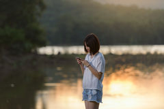 Young woman texting on smartphone Royalty Free Stock Photo
