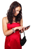 Young woman texting on touch screen phone. Isolated on white background Stock Image