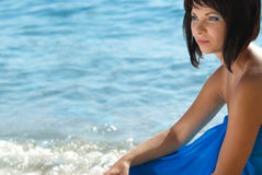 Young woman on th beach Royalty Free Stock Image