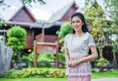 Woman in Thai traditional dress at wooden house stock photo