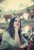 Young woman theatre goer looking at play Royalty Free Stock Photography