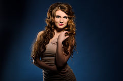 Young woman with thick wavy hair Stock Images