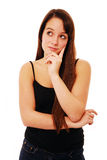 Young woman thinking. Attractive young woman thinking to herself isolated on white royalty free stock photos