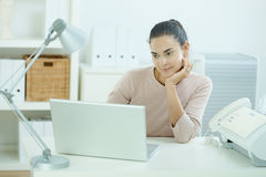 Young woman thinking Royalty Free Stock Photos