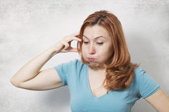 Young woman thinking Stock Photography