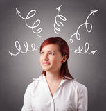 Young woman thinking with arrows overhead Royalty Free Stock Images