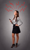 Young woman thinking with arrows overhead Royalty Free Stock Photography