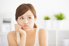 Young woman thinking Royalty Free Stock Photo