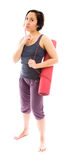 Young woman thinking with carrying exercise mat Stock Image