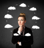 Young woman thinking with cloud circulation around her head Royalty Free Stock Photography