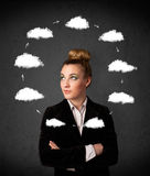 Young woman thinking with cloud circulation around her head Royalty Free Stock Images