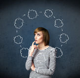 Young woman thinking with cloud circulation around her head Stock Images