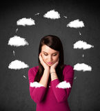 Young woman thinking with cloud circulation around her head Stock Image