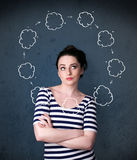 Young woman thinking with cloud circulation around her head Royalty Free Stock Photos