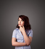 Young woman thinking with copy space Stock Photos