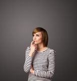 Young woman thinking with copy space Stock Images