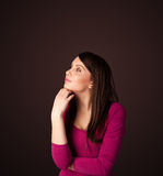 Young woman thinking with copy space Stock Photo