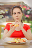 Young Woman Thinking About Eating Pizza on a Diet Stock Image