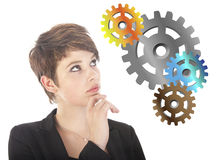 Young woman thinking with gears Royalty Free Stock Photo