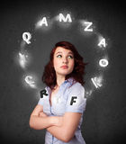 Young woman thinking with letter circulation around her head Royalty Free Stock Images