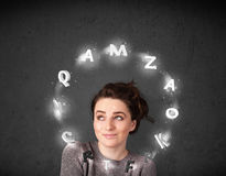 Young woman thinking with letter circulation around her head Stock Photos