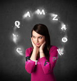 Young woman thinking with letter circulation around her head Stock Image