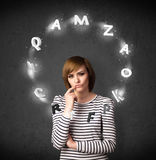 Young woman thinking with letter circulation around her head Stock Images