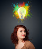 Young woman thinking with lightbulb above her head Stock Photography